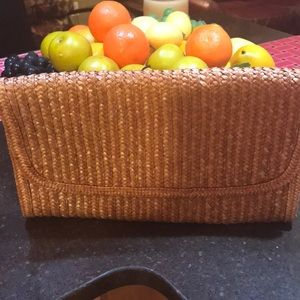 Handbags - Nice straw clutch new with out tags